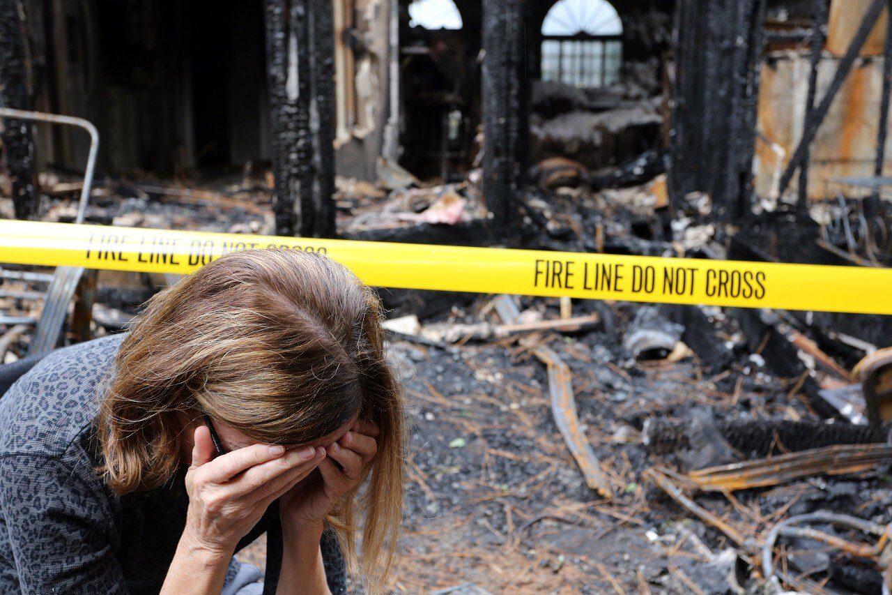 Burned house and upset women